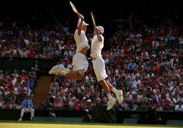 The Bryan twins - the most successful Doubles pair of all-time doing their customary chest bump celebration after winning the Wimbledon Championships in 2013