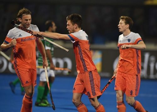 Netherlands' players celebrate after scoring against Pakistan in the Pool stage