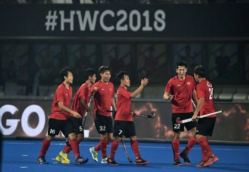 Chinese players celebrating after scoring a goal against Ireland during the 2018 Hockey World Cup