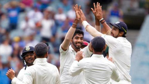 Team India celebrate after dismissing Pat Cummins