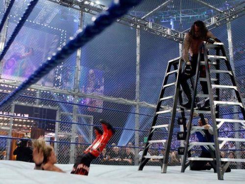The Undertaker chokeslams the rated- superstar through Matt from the Ladder
