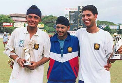 Yuvraj (far right) shows his player of the tournament trophy.