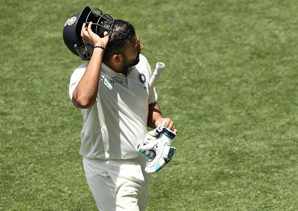 Rohit Sharma got himself out while trying to take the aerial route against Nathan Lyon
