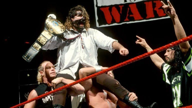 Mick Foley hoisting that elusive title