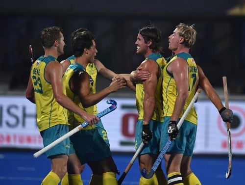Australian players celebrate after scoring a goal against France in the quarterfinal
