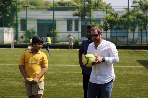 South United Football Club Head Coach Miquel Llado with the students of Vaels International School