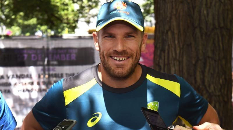 Australia opening batsman Aaron Finch has declared himself fit for the Boxing Day Test against India in Melbourne and said his injured finger would need to be cut off to prevent him from playing in front of his home state's fans. (Photo: AFP)