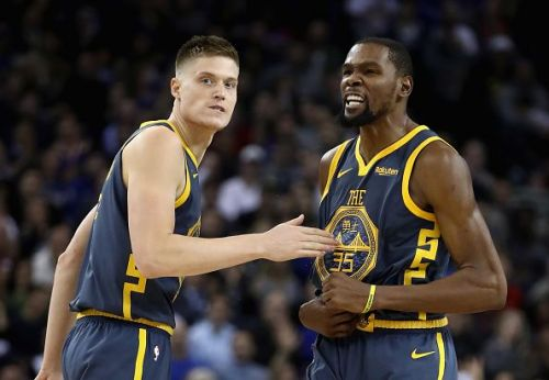 Golden State Warriors star Kevin Durant and Jonas Jerebko in action.
