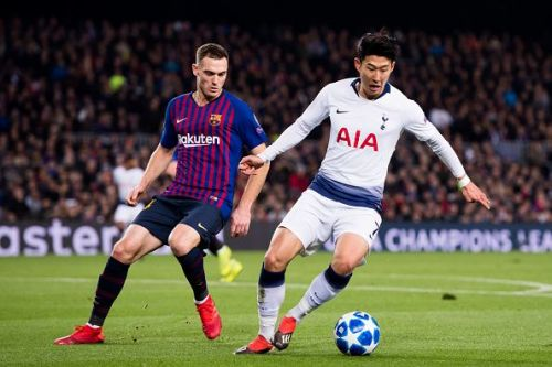 Thomas Vermaelen vying the ball against Son Heung-min in Champions League group clash