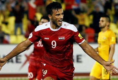 Omar Al Somah celebrating a goal