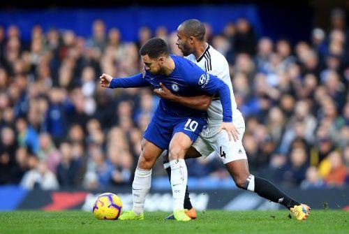 Eden Hazard harassed by Fulham defender Odoi