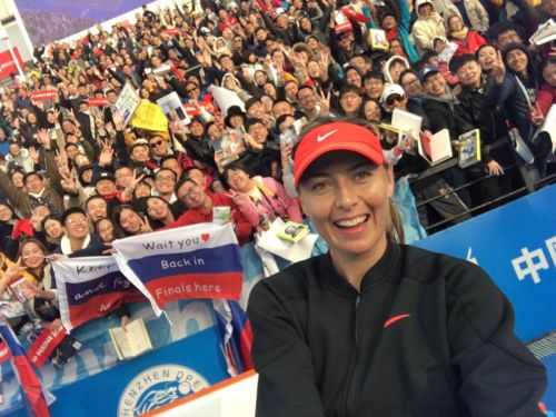 Maria Sharapova takes a picture with her fans after her opening round win at the Shenzhen Open