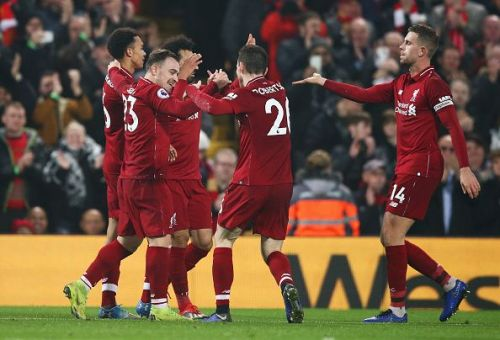 Liverpool players celebrate a goal against Newcastle