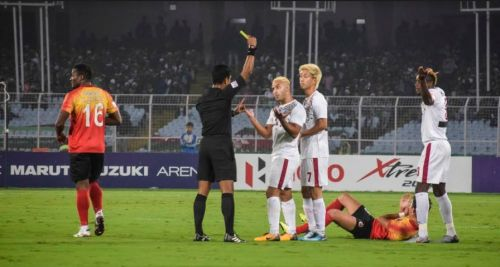 Mohun Bagan players argue after Eze Kingsley (right) is shown a yellow card