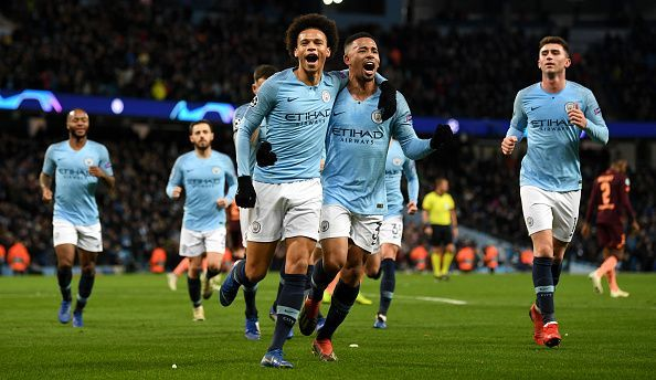 Sane wheels away to celebrate one of his two goals with his City teammates