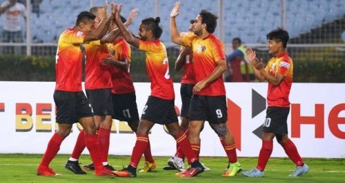 East Bengal players celebrate a goal
