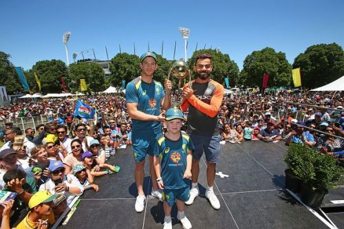 Tim Paine and Virat Kohli along with Archie Schiller from Make-A-Wish Foundation