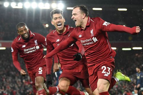 Shaqiri celebrates with Wijnaldum and Firmino after scoring against Manchester United