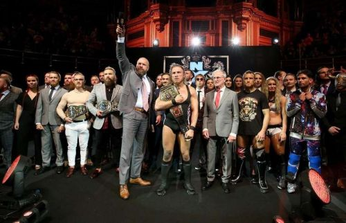 The NXT UK roster, with Triple H and GM Johnny Saint.