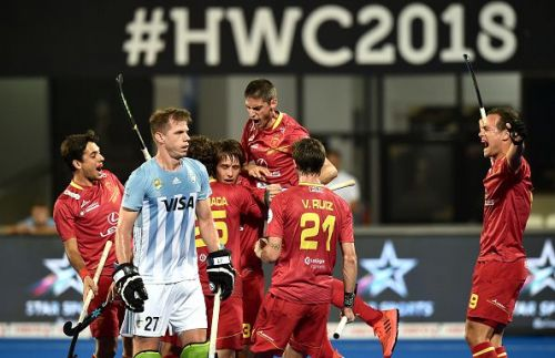Spanish players celebrate after scoring a goal against Argentina