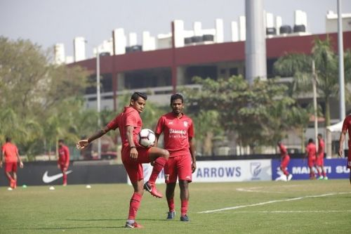 Churchill Brothers' players warm up before the I-League match against Indian Arrows at the practice pitch of the Kalinga Stadium. The main ground is visible in the background (Image: AIFF Media)