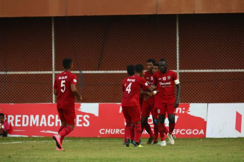 Churchill Brothers' players celebrate after a goal