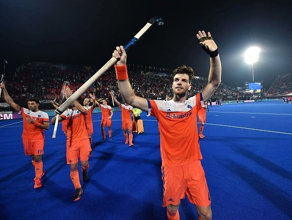 The Dutch players acknowledge the crowd at the Kalinga Stadium