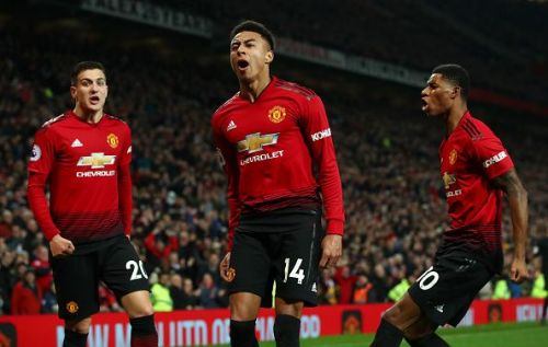 Lingard celebrates his equaliser in front of Stretford End