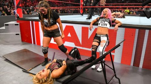 Why was Natalya put through a wooden table?