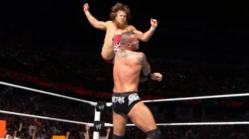 Bryan delivers a front missile drop kick to Randy Orton