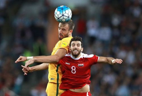Mahmoud Al Mawas (jersey no 8) in action at Australia v Syria - 2018 FIFA World Cup Asian Playoff: Leg 2