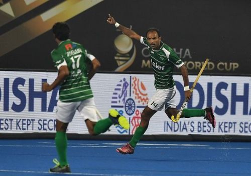 Pakistani players in action during their match against the Netherlands at the 2018 Men's Hockey World Cup