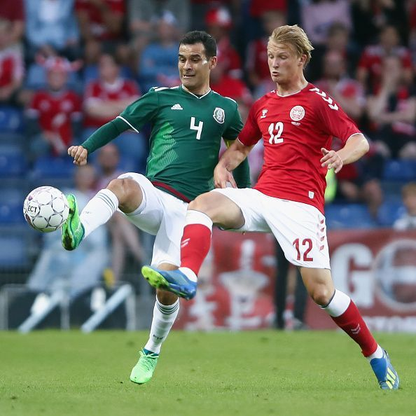 Dolberg (right) in action for Denmark during an international friendly against Mexico