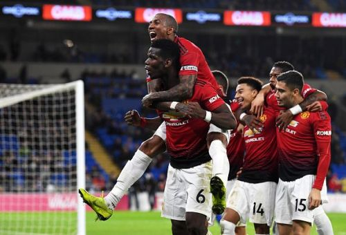 Pogba celebrating Jesse Lingard's goal with his team-mates in front of the traveling supporters