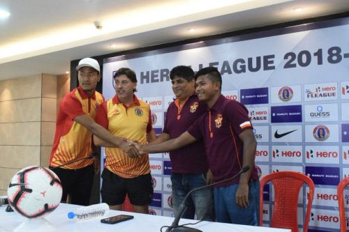 The two coach and players at the pre-match press conference