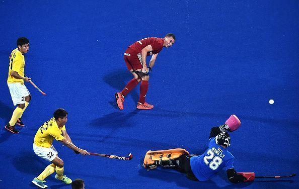 Wang Caiyu making a save against England