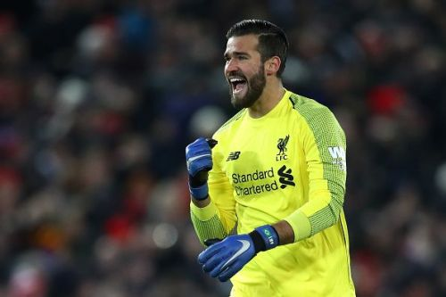 Alisson celebrates a goal against Manchester United at Anfield