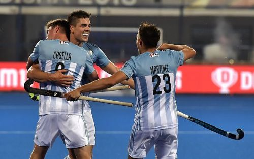 Argentinian players celebrating after scoring a goal against Spain