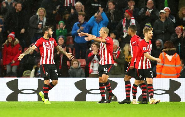 Charlie Austin (far left) celebrates his late winner to sink Arsenal