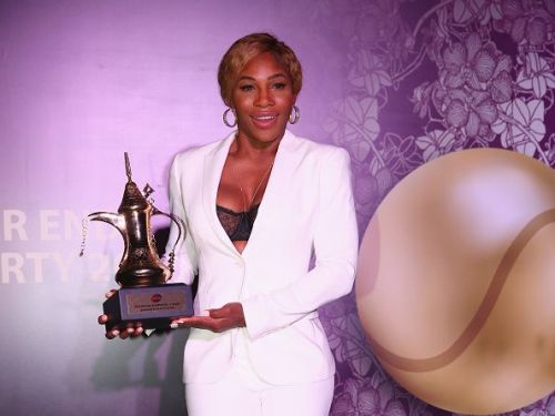 Serena Williams with the World Number 1 trophy presented to her at the BNP Paribas WTA Finals: Singapore 2014