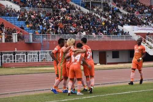 NEROCA FC players celebrate Katsumi Yusa's goal against Churchill Brothers