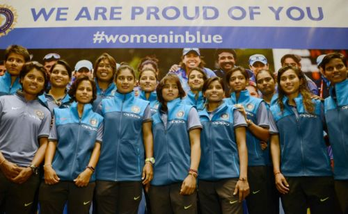 Women in Blue sporting a smile during an event
