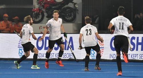 Canadian players celebrate after scoring their goal against Belgium