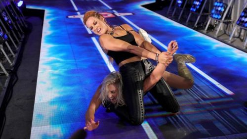 Becky putting Charlotte in Dis Arm Her