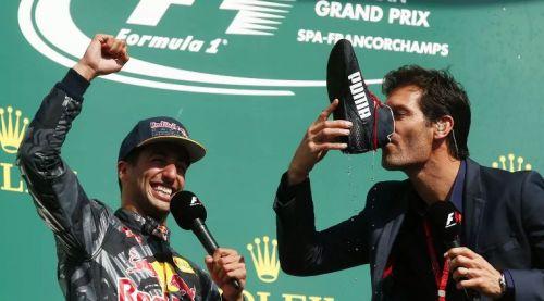 Ricciardo on the Spa podium with Mark Webber doing the shoey