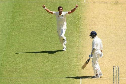 Mitchell Starc celebrates after dismissing Vijay on Day 1