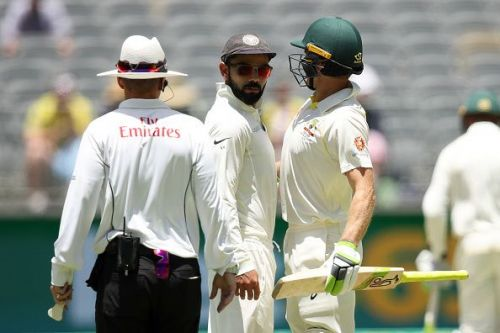 Virat Kohli and Tim Paine (r)