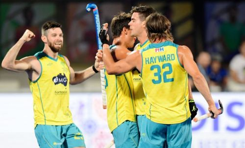 Australian players celebrate after scoring a goal against Ireland in their first match