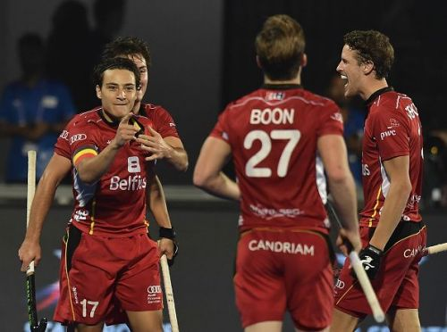 Belgian players celebrate after scoring against Canada