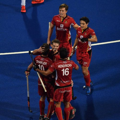 Cedric Charlier is congratulated by his teammates after scoring Belgium's third goal